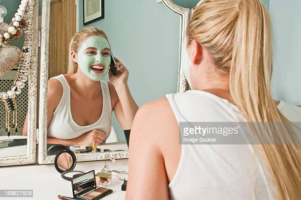 Woman in face mask on the phone