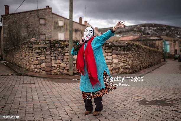 A woman in fancy dress dances as she joins a carnival festival on February 14 2015 in Luzon Spain Every year Luzon hosts one of the leastknown...