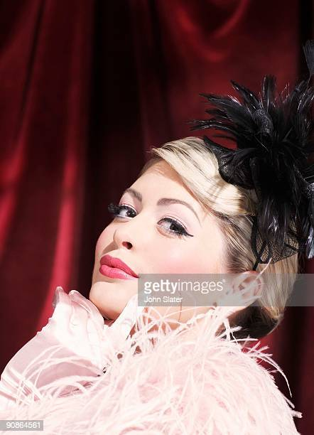woman in feather boa - burlesque stock pictures, royalty-free photos & images
