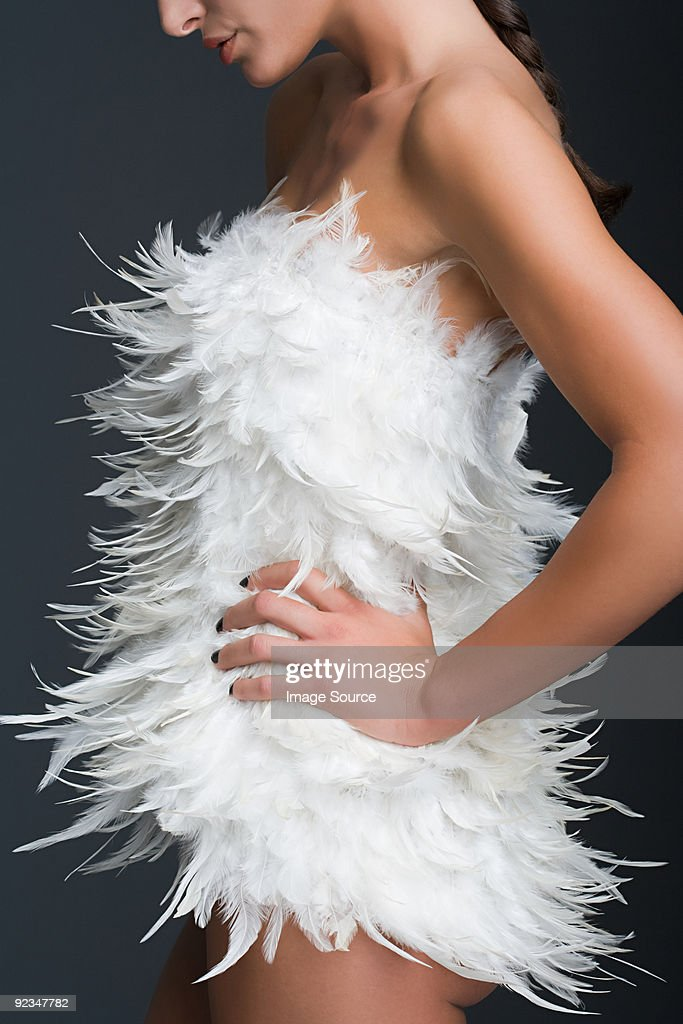 Woman in feathered dress : Stock Photo