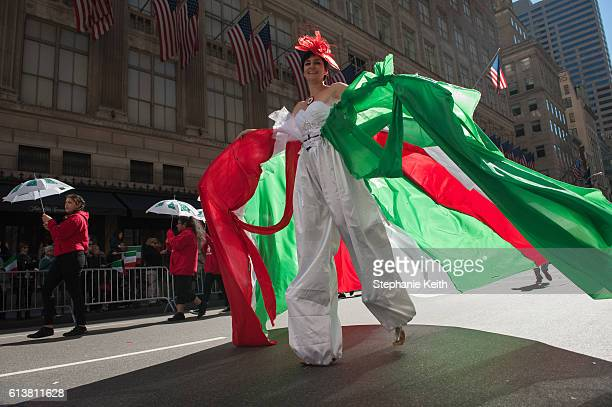 A woman in festive dress walks in the annual Columbus Day Parade on October 10 2016 in New York City This is the 72nd Columbus Day Parade held in New...