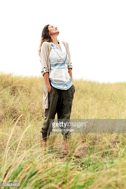 woman in field looking up - nature stock pictures, royalty-free photos & images
