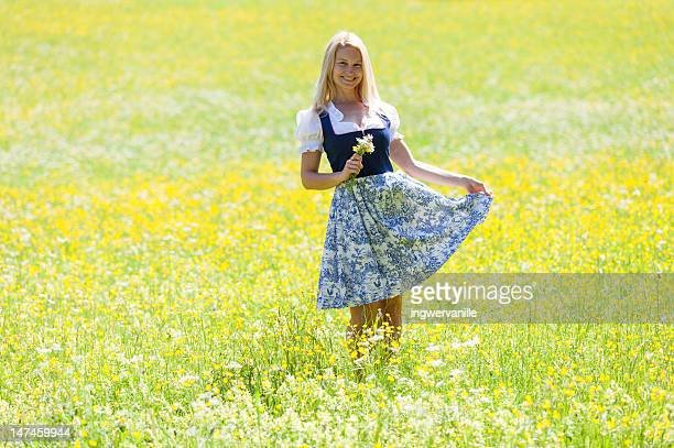woman in field - traditionally austrian stock pictures, royalty-free photos & images