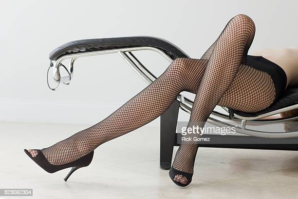 Woman in Fishnet Stockings on a Lounger