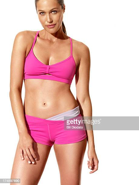 Woman in fitness clothes looking at camera
