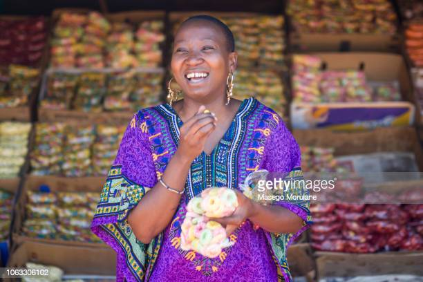 woman eating skopas - soweto stock pictures, royalty-free photos & images