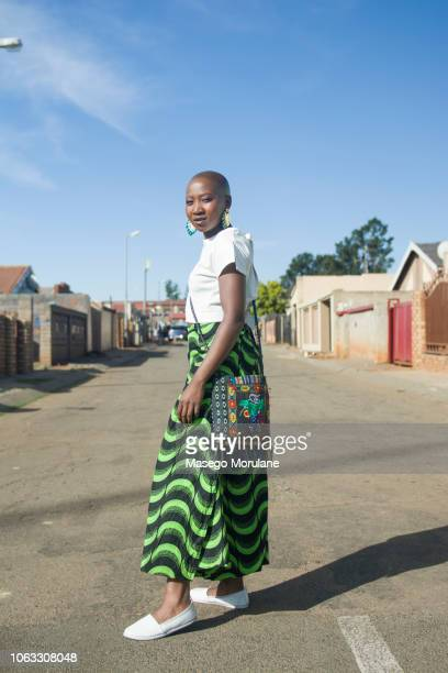 woman walking confidently - soweto stock pictures, royalty-free photos & images