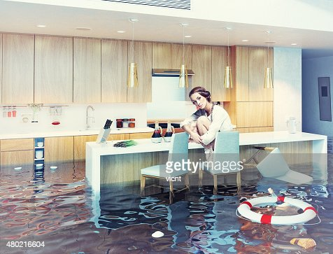 kitchen sink flooding in flooded kitchen interior stock photo thinkstock 2714