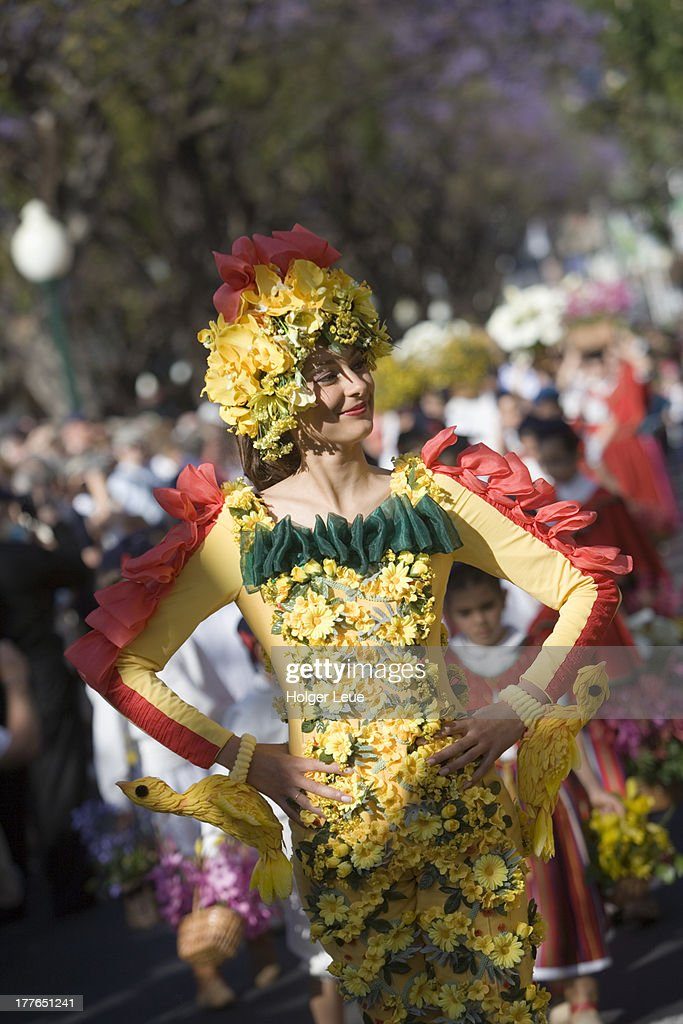 Woman in floral costume at parade : Foto de stock