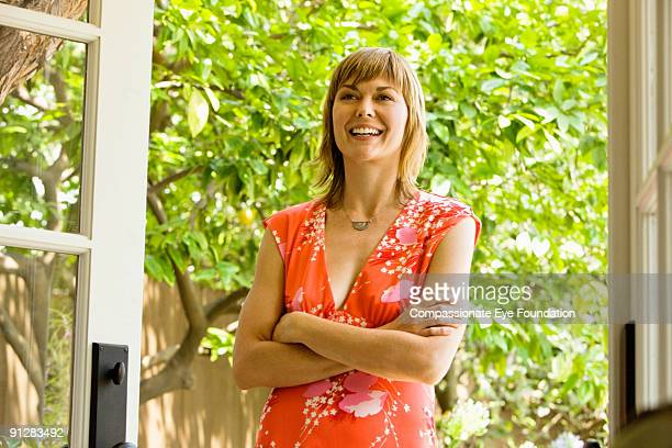 "woman in flowered dress smiling, arms crossed - ""compassionate eye"" stock pictures, royalty-free photos & images"