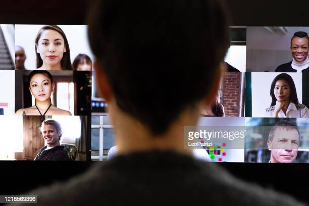 woman in front of a device screen in video conference for work - conference stock pictures, royalty-free photos & images