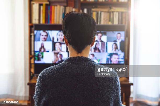 woman in front of a device screen in video conference for work - video conference stock pictures, royalty-free photos & images