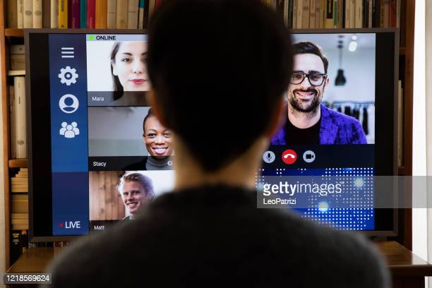 woman in front of a device screen in video conference for work - science and technology stock pictures, royalty-free photos & images