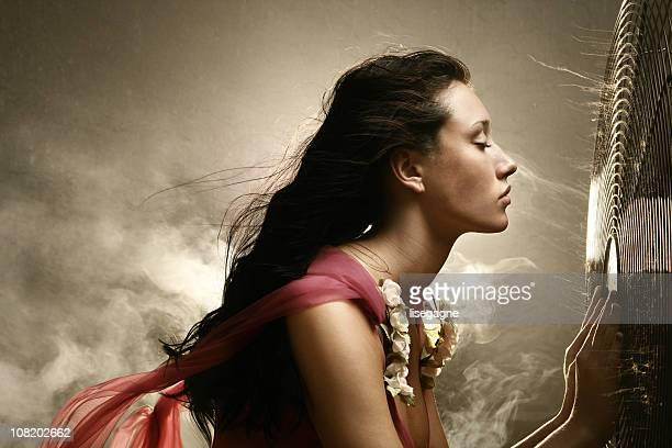 Woman in front of a fan