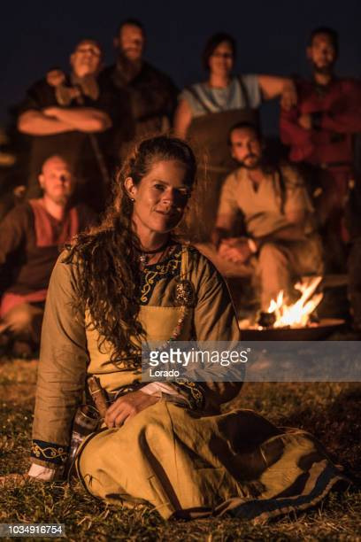 woman in front of a viking campfire - medium group of people stock pictures, royalty-free photos & images