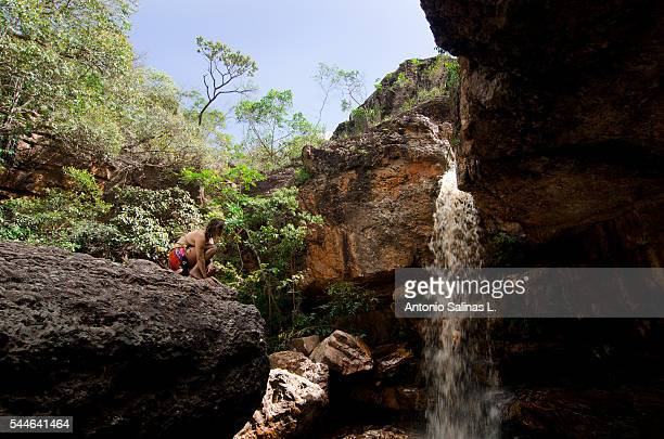 A woman in front of a waterfall, Chapada Diamantina . Brazil