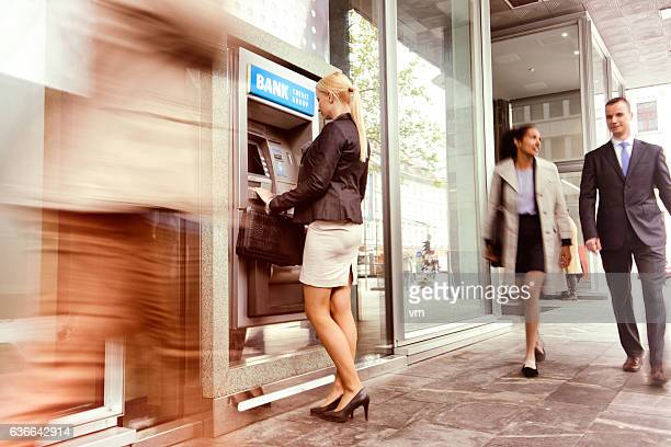 Woman in front of an ATM machine