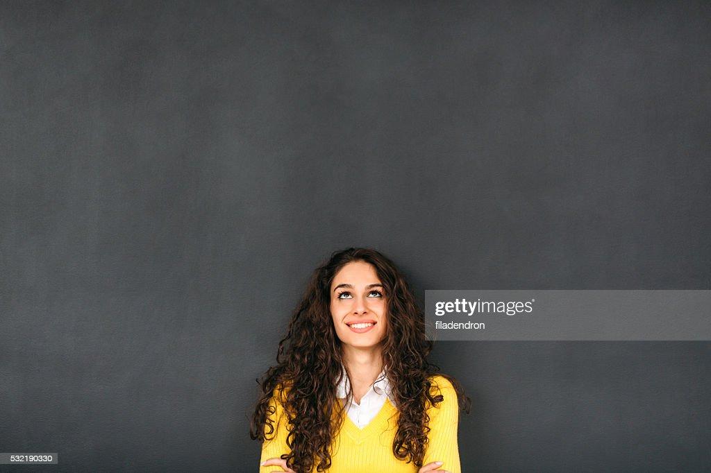 Woman In Front of Blackboard : Stock Photo