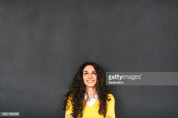 woman in front of blackboard - blackboard stock photos and pictures