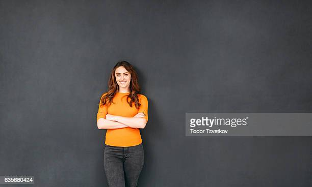 woman in front of blackboard - chalkboard stock photos and pictures