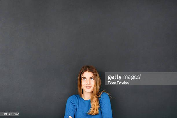 Woman In Front of Blackboard