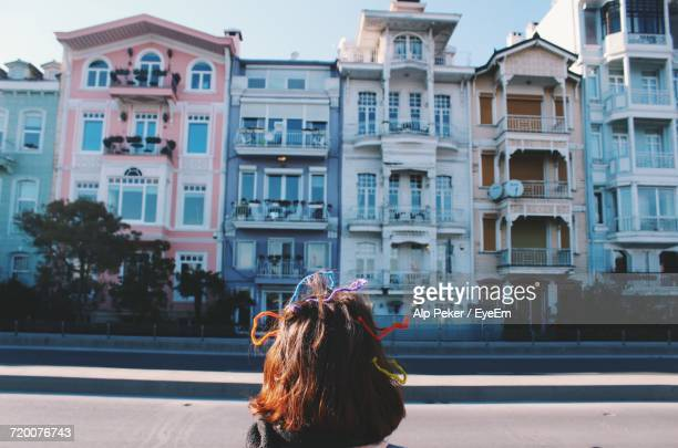 Woman In Front Of Buildings In City