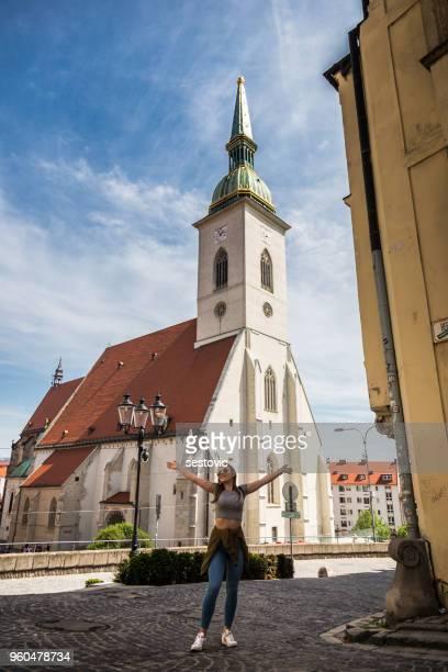 woman in front of cathedral in bratislava, slovakia - eslováquia imagens e fotografias de stock