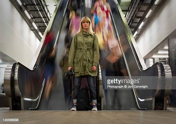 woman in front of escalator - motion stock pictures, royalty-free photos & images
