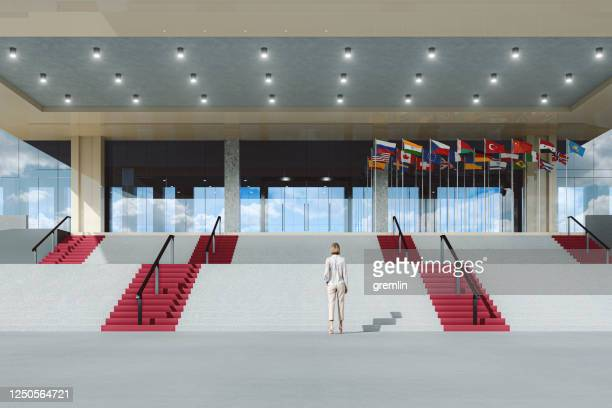 woman in front of government building - politician stock pictures, royalty-free photos & images