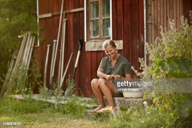 woman in front of house - gotland bildbanksfoton och bilder