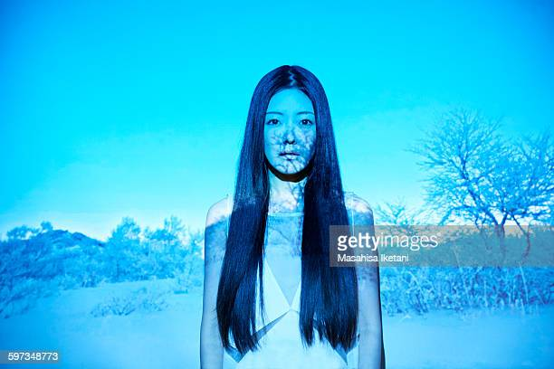 Woman in front of projection screen with snow scen