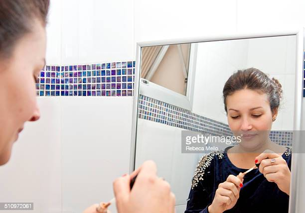 woman in front of the mirror, starting makeup - concealer stock pictures, royalty-free photos & images