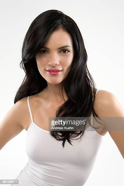 Woman in front of white backgroung smiling.