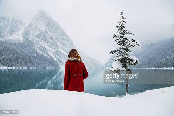 Woman in front of winter wonderland lake Louise