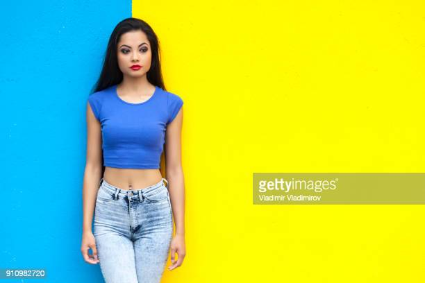 Woman in front of yellow and blue wall background