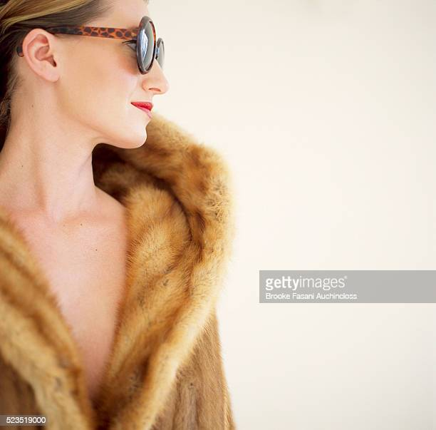 woman in fur coat and sunglasses - fur coat stock pictures, royalty-free photos & images