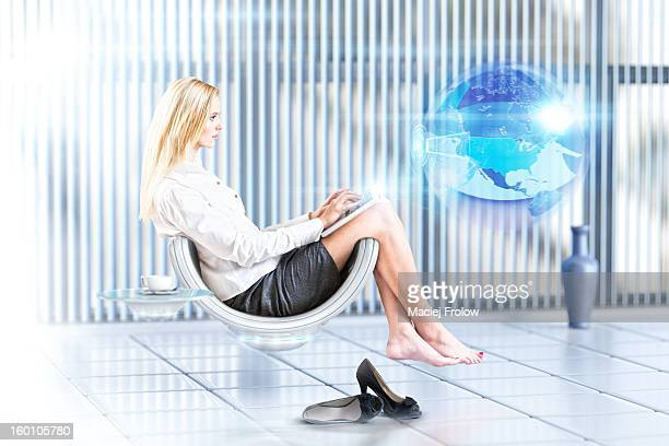 Woman in futuristic room with 3D display