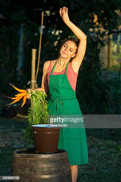 Woman In Garden Holding Carrots, Croatia, Slavonia, Europe