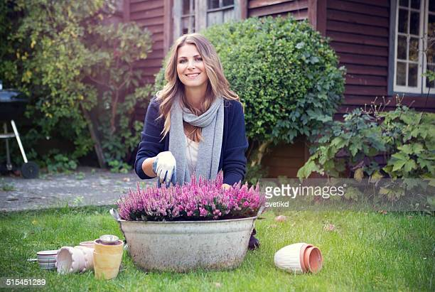 woman in garden. - flower pot stock pictures, royalty-free photos & images