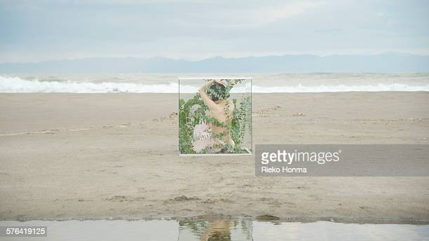 Woman in glass cube