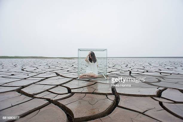 woman in glass cube - despair stock pictures, royalty-free photos & images