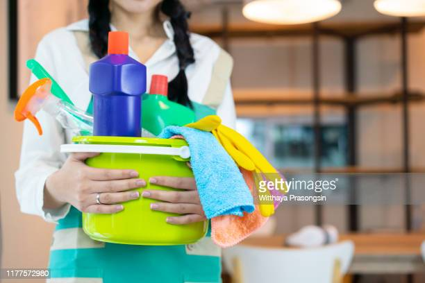 woman in gloves cleaning with cleanser - nhs staff stock pictures, royalty-free photos & images