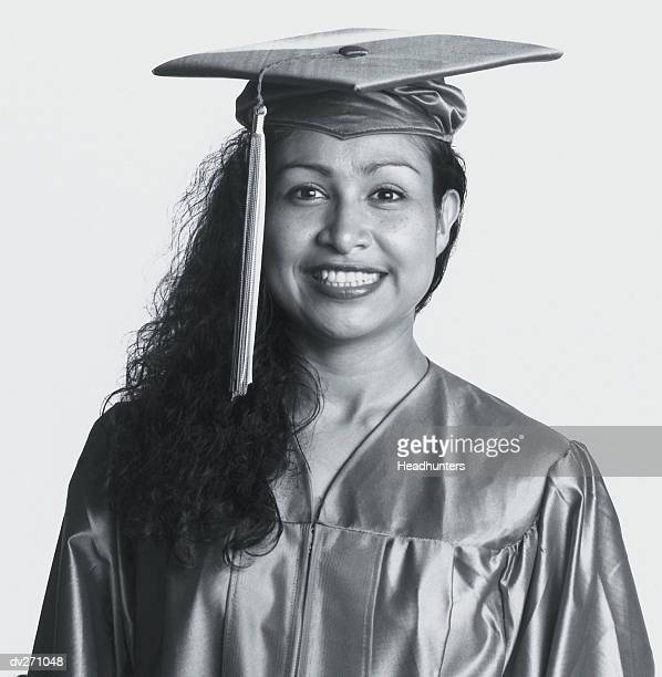woman in graduation cap and gown - headhunters stock pictures, royalty-free photos & images