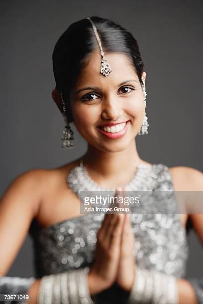 woman in gray sari smiling at camera, hands together - prayer pose greeting bildbanksfoton och bilder