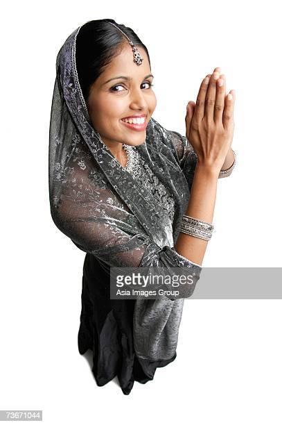 woman in gray sari standing against white background, hands together - prayer pose greeting bildbanksfoton och bilder