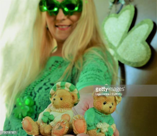 woman in green sunglasses with stuffed toys at home - liga cerina stock pictures, royalty-free photos & images