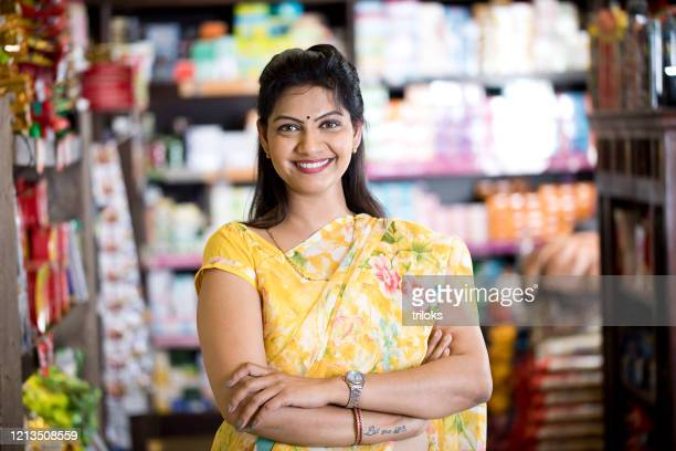 woman in grocery aisle of supermarket - indian culture stock pictures, royalty-free photos & images