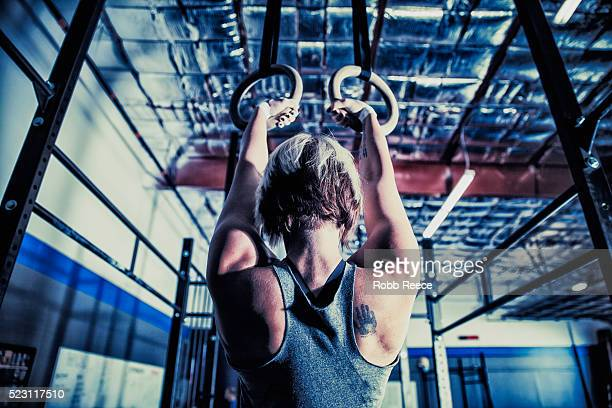 woman in gym gym doing pull-ups - robb reece stock pictures, royalty-free photos & images