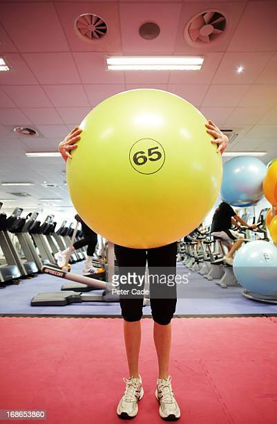 woman in gym holding large exercise ball - obscured face stock pictures, royalty-free photos & images