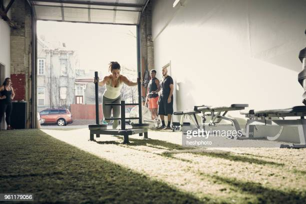 woman in gym using exercise equipment - heshphoto stock pictures, royalty-free photos & images